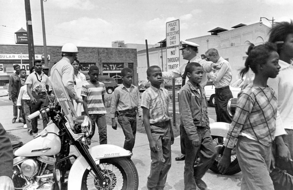 Police lead a group of black school children to jail after their arrest for protesting against racial discrimination near city hall in Birmingham, Ala Measuring MLKs Dream, Birmingham, USA