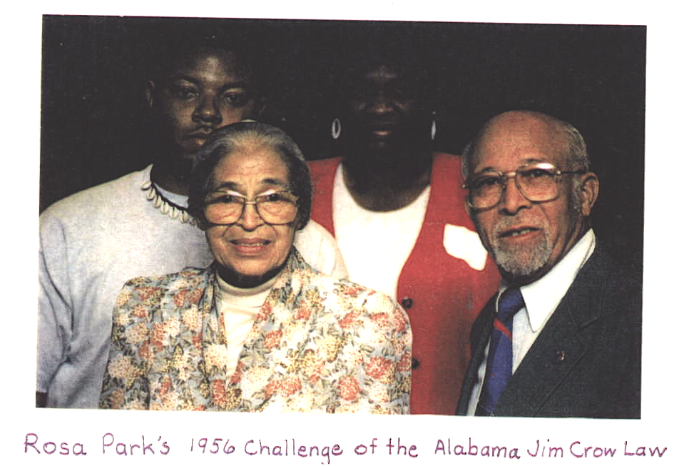 Photograph of Rosa Parks and Charles Golding, and two unnamed individuals in the background, smiling for the camera.