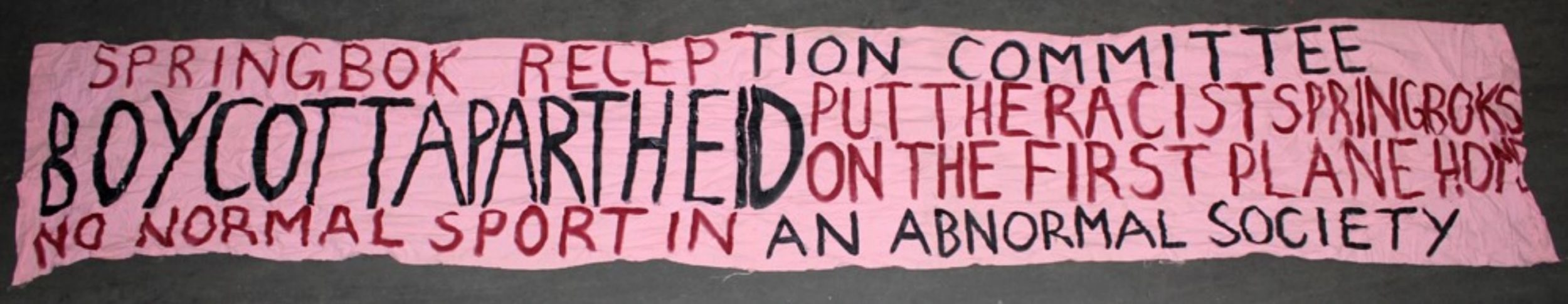 """A banner with the message """"Springbok reception committee. Boycott apartheid. Put the racist Springboks on the first plane home. No normal sport in an abnormal society."""""""