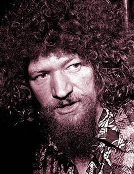 Black and white portrait image of Luke Kelly with curly hair and beard